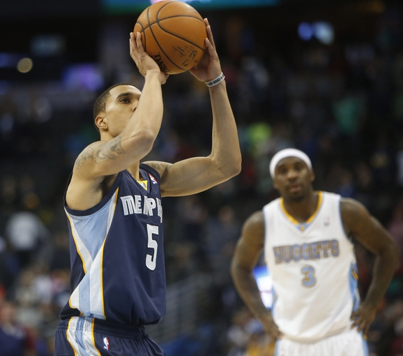 Mar 31, 2014; Denver, CO, USA; Memphis Grizzlies guard Courtney Lee (5) shoots the ball during the second half against the Denver Nuggets at Pepsi Center.  The Grizzlies won 94-92.  Mandatory Credit: Chris Humphreys-USA TODAY Sports