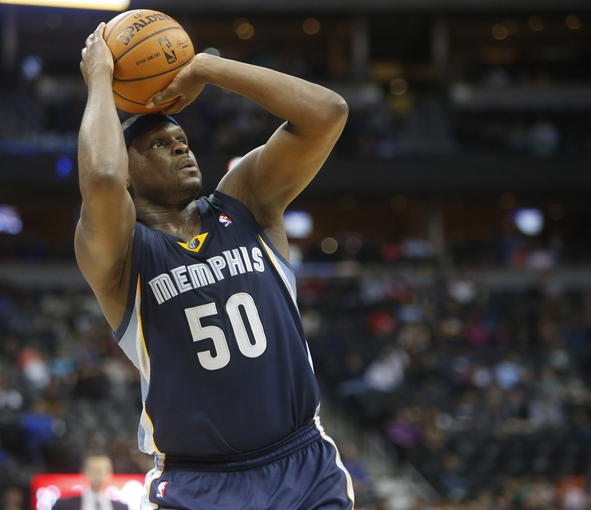 Mar 31, 2014; Denver, CO, USA; Memphis Grizzlies forward Zach Randolph (50) shoots the ball during the second half against the Denver Nuggets at Pepsi Center.  The Grizzlies won 94-92.  Mandatory Credit: Chris Humphreys-USA TODAY Sports