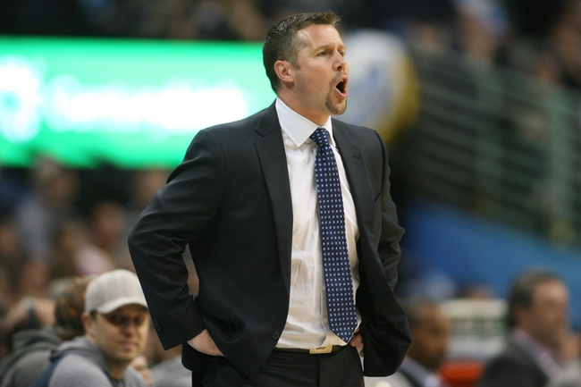 Mar 31, 2014; Denver, CO, USA; Memphis Grizzlies head coach David Joerger yells from the sidelines during the second half against the Denver Nuggets at Pepsi Center.  The Grizzlies won 94-92.  Mandatory Credit: Chris Humphreys-USA TODAY Sports