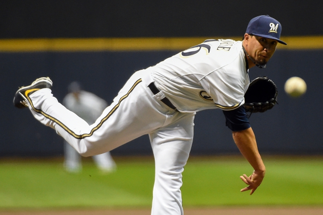 Apr 1, 2014; Milwaukee, WI, USA;  Milwaukee Brewers pitcher Kyle Lohse (26) pitches in the first inning against the Atlanta Braves at Miller Park. Mandatory Credit: Benny Sieu-USA TODAY Sports