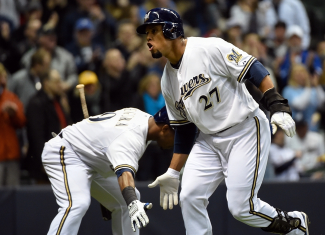 Apr 1, 2014; Milwaukee, WI, USA;  Milwaukee Brewers center fielder Carlos Gomez (27) reacts with shortstop Jean Segura (9) after hitting a home run in the first inning against the Atlanta Braves at Miller Park. Mandatory Credit: Benny Sieu-USA TODAY Sports