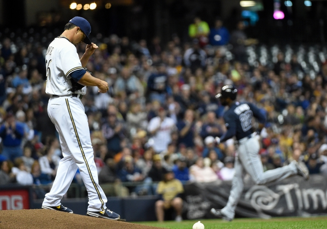 Apr 1, 2014; Milwaukee, WI, USA;  Milwaukee Brewers pitcher Kyle Lohse (26) reacts as Atlanta Braves right fielder Jason Heyward (22) runs the bases after hitting a 2-run home run in the fifth inning at Miller Park. Mandatory Credit: Benny Sieu-USA TODAY Sports