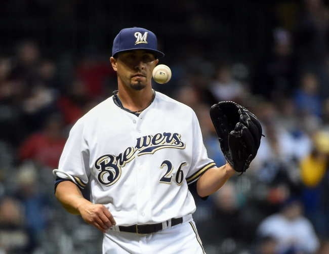 Apr 1, 2014; Milwaukee, WI, USA;  Milwaukee Brewers pitcher Kyle Lohse (26) tosses a new baseball after giving up a home run to Atlanta Braves first baseman Freddie Freeman (not pictured) in the sixth inning at Miller Park. Mandatory Credit: Benny Sieu-USA TODAY Sports