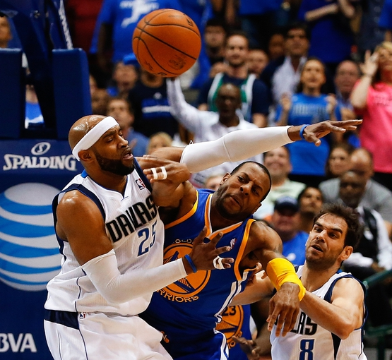 Apr 1, 2014; Dallas, TX, USA; Dallas Mavericks guard Vince Carter (25) battles for the ball with Golden State Warriors forward Andre Iguodala (9) during the second quarter at American Airlines Center. Mandatory Credit: Kevin Jairaj-USA TODAY Sports