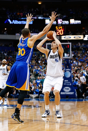 Apr 1, 2014; Dallas, TX, USA; Dallas Mavericks forward Dirk Nowitzki (41) shoots during the second quarter against Golden State Warriors guard Stephen Curry (30) at American Airlines Center. Mandatory Credit: Kevin Jairaj-USA TODAY Sports