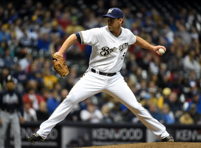 Apr 1, 2014; Milwaukee, WI, USA;  Milwaukee Brewers pitcher Zach Duke (59) pitches in the eighth inning against the Atlanta Braves at Miller Park. Mandatory Credit: Benny Sieu-USA TODAY Sports