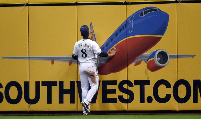Apr 1, 2014; Milwaukee, WI, USA;  Milwaukee Brewers left fielder Ryan Braun (8) watches the home run hit by Atlanta Braves first baseman Freddie Freeman (not pictured) fly into the stands in the eighth inning at Miller Park. Mandatory Credit: Benny Sieu-USA TODAY Sports