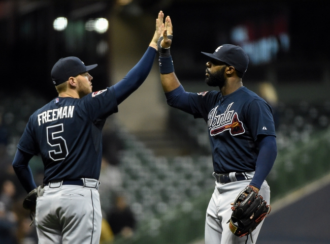 Apr 1, 2014; Milwaukee, WI, USA;  Atlanta Braves first baseman Freddie Freeman (5) and right fielder Jason Heyward (22) celebrate after beating the Milwaukee Brewers 5-2. at Miller Park. Mandatory Credit: Benny Sieu-USA TODAY Sports