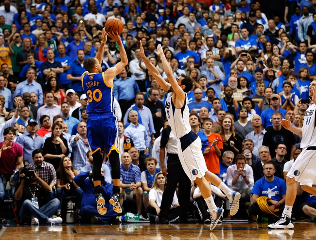 Apr 1, 2014; Dallas, TX, USA; Golden State Warriors guard Stephen Curry (30) hits the game winning shot in overtime over Dallas Mavericks guard Jose Calderon (8) at American Airlines Center. Mandatory Credit: Kevin Jairaj-USA TODAY Sports