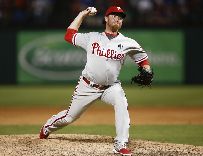Apr 1, 2014; Arlington, TX, USA; Philadelphia Phillies relief pitcher B.J. Rosenberg (39) delivers a pitch to the Texas Rangers during the ninth inning at Globe Life Park in Arlington. The Texas Rangers won 3-2. Mandatory Credit: Jim Cowsert-USA TODAY Sports