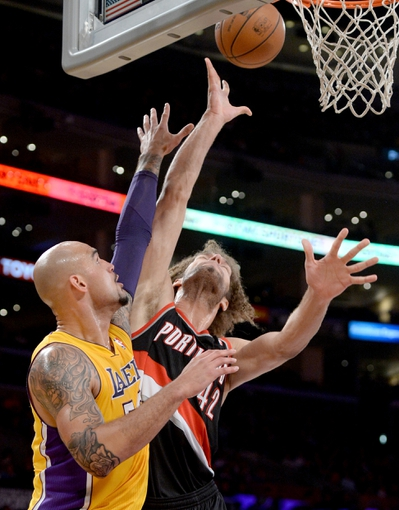 Apr 1, 2014; Los Angeles, CA, USA;    Los Angeles Lakers center Robert Sacre (50) defends Portland Trail Blazers center Robin Lopez (42) during the first half of the game at Staples Center. Mandatory Credit: Jayne Kamin-Oncea-USA TODAY Sports