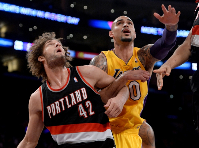 Apr 1, 2014; Los Angeles, CA, USA;    Los Angeles Lakers center Robert Sacre (50) and Portland Trail Blazers center Robin Lopez (42) battle for a rebound during the first half of the game at Staples Center. Mandatory Credit: Jayne Kamin-Oncea-USA TODAY Sports