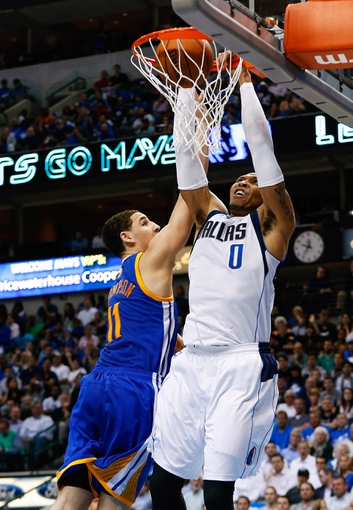 Apr 1, 2014; Dallas, TX, USA; Dallas Mavericks forward Shawn Marion (0) dunks over Golden State Warriors guard Klay Thompson (11) during the game at American Airlines Center. Golden State won 122-120. Mandatory Credit: Kevin Jairaj-USA TODAY Sports