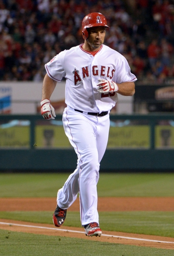 Apr 1, 2014; Anaheim, CA, USA; Los Angeles Angels designated hitter Raul Ibanez (28) rounds the bases after hitting a two-run home run in the fourth inning against the Seattle Mariners at Angel Stadium of Anaheim. Mandatory Credit: Kirby Lee-USA TODAY Sports