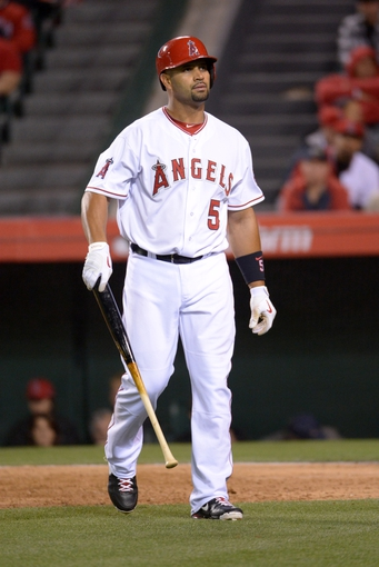 Apr 1, 2014; Anaheim, CA, USA; Los Angeles Angels first baseman Albert Pujols (5) reacts after striking out in the fifth inning against the Seattle Mariners at Angel Stadium of Anaheim. Mandatory Credit: Kirby Lee-USA TODAY Sports