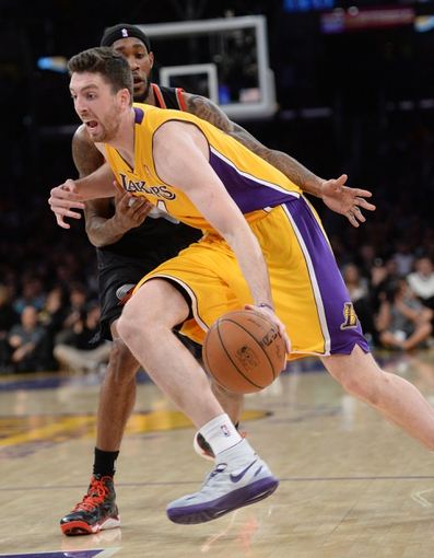 Apr 1, 2014; Los Angeles, CA, USA;  Portland Trail Blazers guard Will Barton (5) guards Los Angeles Lakers forward Ryan Kelly (4) during the second half of the game at Staples Center. Trail Blazers won 124-112. Mandatory Credit: Jayne Kamin-Oncea-USA TODAY Sports