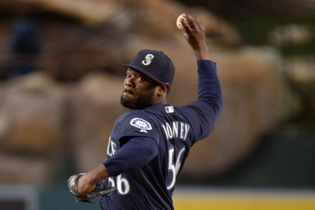 Apr 1, 2014; Anaheim, CA, USA; Seattle Mariners reliever Fernando Rodney (56) delivers a pitch in the ninth inning against the Los Angeles Angels at Angel Stadium of Anaheim. The Mariners defeated the Angels 8-3. Mandatory Credit: Kirby Lee-USA TODAY Sports