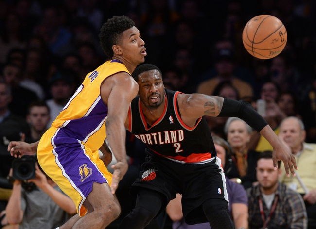Apr 1, 2014; Los Angeles, CA, USA;  Los Angeles Lakers forward Nick Young (0) steals the ball from Portland Trail Blazers guard Wesley Matthews (2) during the second half of the game at Staples Center. Trail Blazers won 124-112. Mandatory Credit: Jayne Kamin-Oncea-USA TODAY Sports