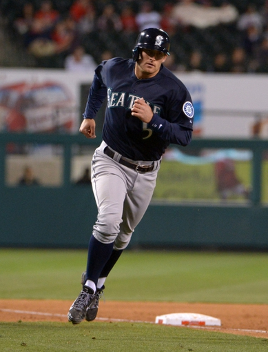 Apr 1, 2014; Anaheim, CA, USA; Seattle Mariners shortstop Brad Miller (5) rounds the bases after hitting a two-run home run in the ninth inning against the Los Angeles Angels at Angel Stadium of Anaheim. The Mariners defeated the Angels 8-3. Mandatory Credit: Kirby Lee-USA TODAY Sports