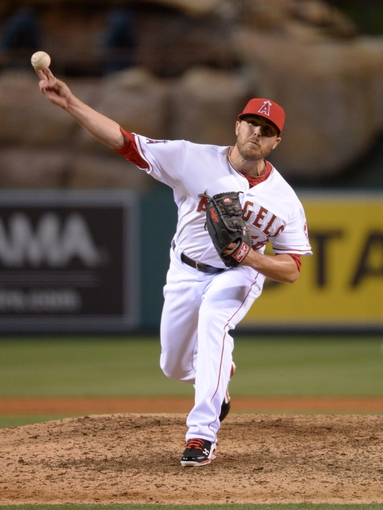 Apr 1, 2014; Anaheim, CA, USA; Los Angeles Angels reliever Michael Kohn (58) delivers a pitch against the Seattle Mariners at Angel Stadium of Anaheim. The Mariners defeated the Angels 8-3. Mandatory Credit: Kirby Lee-USA TODAY Sports