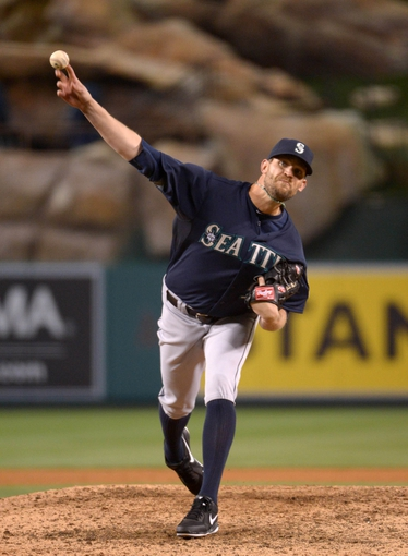 Apr 1, 2014; Anaheim, CA, USA; Seattle Mariners reliever Tom Wilhelmsen (54) delivers a pitch against the Los Angeles Angels at Angel Stadium of Anaheim. The Mariners defeated the Angels 8-3. Mandatory Credit: Kirby Lee-USA TODAY Sports