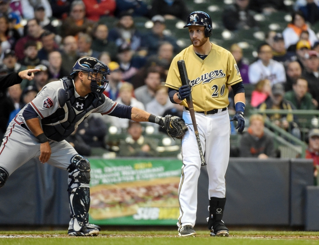 Apr 2, 2014; Milwaukee, WI, USA;  Atlanta Braves catcher Gerald Laird (11) tags Milwaukee Brewers catcher Jonathan Lucroy (20) after he struck out in the second inning at Miller Park. Mandatory Credit: Benny Sieu-USA TODAY Sports