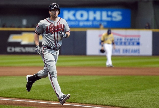 Apr 2, 2014; Milwaukee, WI, USA;   Atlanta Braves third baseman Chris Johnson (23) runs the bases after hitting a solo home run in the seventh inning against the Milwaukee Brewers at Miller Park. Mandatory Credit: Benny Sieu-USA TODAY Sports
