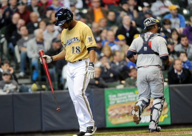 Apr 2, 2014; Milwaukee, WI, USA;   Milwaukee Brewers left fielder Khris Davis (18) walks back to the dugout after striking out in the eighth inning during the game against the Atlanta Braves at Miller Park. The Braves beat the Brewers 1-0.  Mandatory Credit: Benny Sieu-USA TODAY Sports