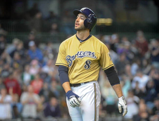 Apr 2, 2014; Milwaukee, WI, USA;   Milwaukee Brewers right fielder Ryan Braun (8) reacts after flying out to end the game against the Atlanta Braves at Miller Park. The Braves beat the Brewers 1-0.  Mandatory Credit: Benny Sieu-USA TODAY Sports