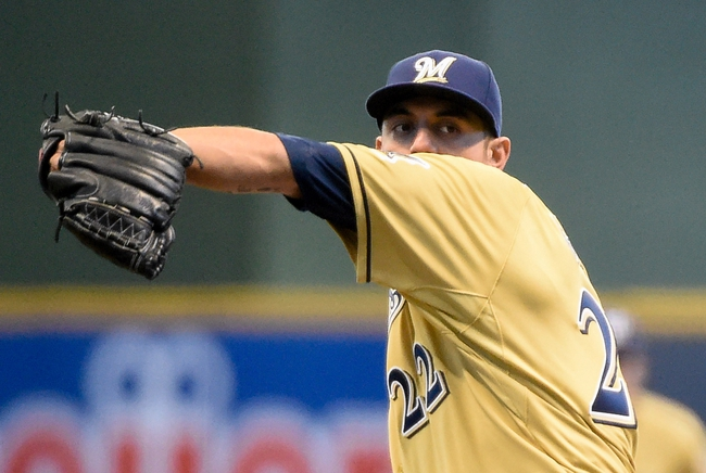 Apr 2, 2014; Milwaukee, WI, USA;   Milwaukee Brewers pitcher Matt Garza (22) pitches in the first inning against the Atlanta Braves at Miller Park. The Braves beat the Brewers 1-0.  Mandatory Credit: Benny Sieu-USA TODAY Sports