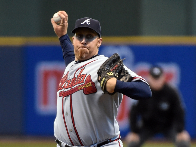 Apr 2, 2014; Milwaukee, WI, USA;  Atlanta Braves pitcher Aaron Harang (34) pitches against the Milwaukee Brewers in the first inning at Miller Park. The Braves beat the Brewers 1-0.  Mandatory Credit: Benny Sieu-USA TODAY Sports