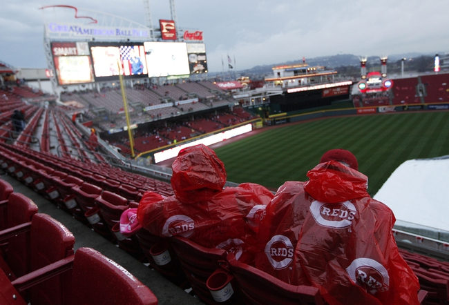 Apr 2, 2014; Cincinnati, OH, USA; Cincinnati Reds fans wait out a rain delay prior to the game between the Cincinnati Reds and the St. Louis Cardinals at Great American Ball Park. Mandatory Credit: Frank Victores-USA TODAY Sports
