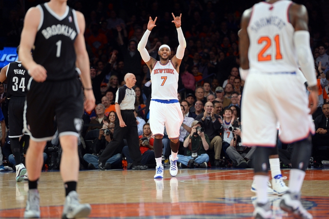 Apr 2, 2014; New York, NY, USA; New York Knicks forward Carmelo Anthony (7) celebrates a basket against the Brooklyn Nets during the first half at Madison Square Garden. Mandatory Credit: Joe Camporeale-USA TODAY Sports