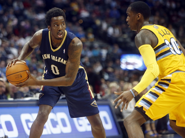 Apr 2, 2014; Denver, CO, USA; New Orleans Pelicans forward Al-Farouq Aminu (0) with the ball against Denver Nuggets forward Quincy Miller (30) during the first half at Pepsi Center. Mandatory Credit: Chris Humphreys-USA TODAY Sports