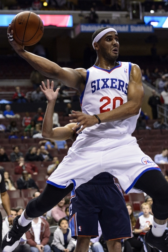 Apr 2, 2014; Philadelphia, PA, USA; Philadelphia 76ers forward Brandon Davies (20) passes the ball during the fourth quarter against the Charlotte Bobcats at the Wells Fargo Center. The Bobcats defeated the Sixers 123-93. Mandatory Credit: Howard Smith-USA TODAY Sports