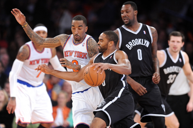 Apr 2, 2014; New York, NY, USA; New York Knicks guard J.R. Smith (8) guards Brooklyn Nets forward Alan Anderson (6) during the second half at Madison Square Garden. The New York Knicks won 110-81. Mandatory Credit: Joe Camporeale-USA TODAY Sports