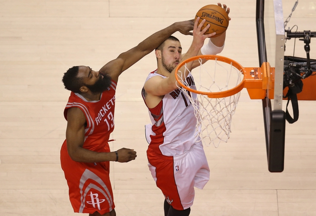Apr 2, 2014; Toronto, Ontario, CAN; Toronto Raptors center Jonas Valanciunas (17) shoots as Houston Rockets guard James Harden (13) tries to defend at Air Canada Centre. The Raptors beat the Rockets 107-103. Mandatory Credit: Tom Szczerbowski-USA TODAY Sports