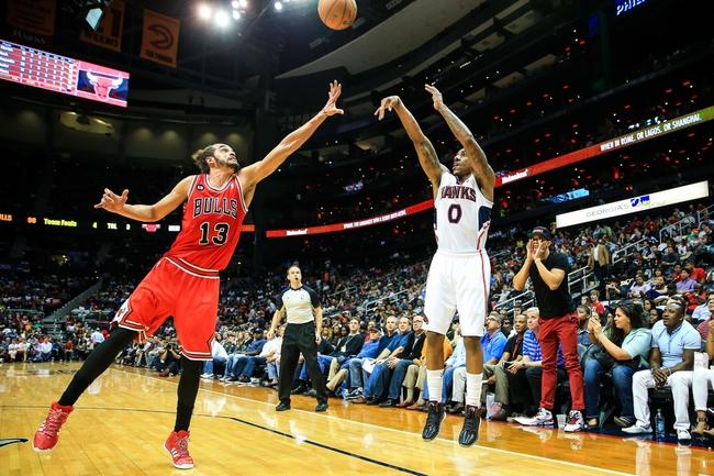 Apr 2, 2014; Atlanta, GA, USA; Atlanta Hawks guard Jeff Teague (0) shoots a three point shot over Chicago Bulls center Joakim Noah (13) in the second half at Philips Arena. The Bulls won 105-92. Mandatory Credit: Daniel Shirey-USA TODAY Sports