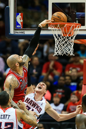 Apr 2, 2014; Atlanta, GA, USA; Chicago Bulls forward Carlos Boozer (5) dunks over Atlanta Hawks center Mike Muscala (31) in the second half at Philips Arena. The Bulls won 105-92. Mandatory Credit: Daniel Shirey-USA TODAY Sports