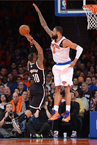 Apr 2, 2014; New York, NY, USA; New York Knicks center Tyson Chandler (6) blocks a shot by Brooklyn Nets guard Marcus Thornton (10) during the second half at Madison Square Garden. The New York Knicks won 110-81. Mandatory Credit: Joe Camporeale-USA TODAY Sports