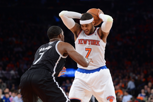 Apr 2, 2014; New York, NY, USA; Brooklyn Nets guard Joe Johnson (7) guards New York Knicks forward Carmelo Anthony (7) during the second half at Madison Square Garden. The New York Knicks won 110-81. Mandatory Credit: Joe Camporeale-USA TODAY Sports