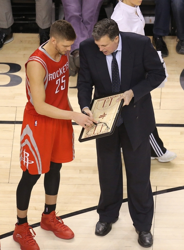 Apr 2, 2014; Toronto, Ontario, CAN; Houston Rockets head coach Kevin McHale talks to forward Chandler Parsons (25) during a timeout against the Toronto Raptors at Air Canada Centre. The Raptors beat the Rockets 107-103. Mandatory Credit: Tom Szczerbowski-USA TODAY Sports