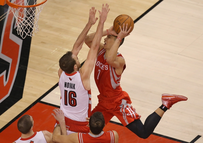 Apr 2, 2014; Toronto, Ontario, CAN; Houston Rockets guard Jeremy Lin (7) goes to the basket against Toronto Raptors forward Steve Novak (16) at Air Canada Centre. The Raptors beat the Rockets 107-103. Mandatory Credit: Tom Szczerbowski-USA TODAY Sports