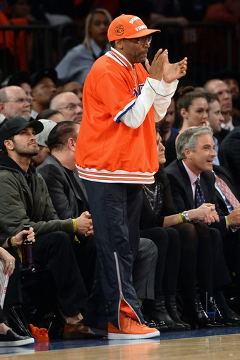 Apr 2, 2014; New York, NY, USA; Actor and director Spike Lee attends the game between the New York Knicks and the Brooklyn Nets during the first half at Madison Square Garden. The New York Knicks won 110-81. Mandatory Credit: Joe Camporeale-USA TODAY Sports