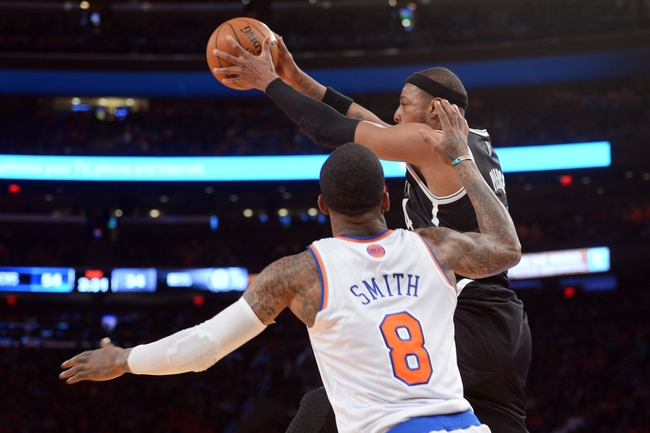 Apr 2, 2014; New York, NY, USA; Brooklyn Nets forward Paul Pierce (34) controls a pass against New York Knicks guard J.R. Smith (8) during the first half at Madison Square Garden. The New York Knicks won 110-81. Mandatory Credit: Joe Camporeale-USA TODAY Sports