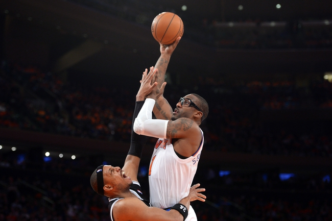 Apr 2, 2014; New York, NY, USA; New York Knicks forward Amar'e Stoudemire (1) shoots over Brooklyn Nets forward Paul Pierce (34) during the second half at Madison Square Garden. The New York Knicks won 110-81. Mandatory Credit: Joe Camporeale-USA TODAY Sports