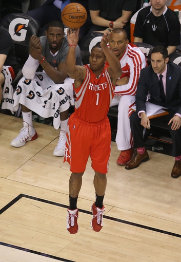 Apr 2, 2014; Toronto, Ontario, CAN; Houston Rockets guard Isaiah Canaan (1) shoots against the Toronto Raptors at Air Canada Centre. The Raptors beat the Rockets 107-103. Mandatory Credit: Tom Szczerbowski-USA TODAY Sports