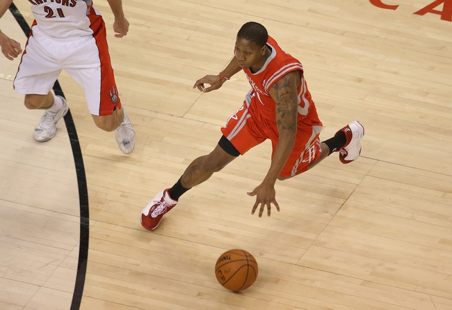 Apr 2, 2014; Toronto, Ontario, CAN; Houston Rockets guard Isaiah Canaan (1) dribbles against the Toronto Raptors at Air Canada Centre. The Raptors beat the Rockets 107-103. Mandatory Credit: Tom Szczerbowski-USA TODAY Sports