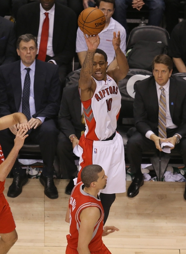 Apr 2, 2014; Toronto, Ontario, CAN; Toronto Raptors guard DeMar DeRozan (10) shoots a three-pointer against the Houston Rockets at Air Canada Centre. The Raptors beat the Rockets 107-103. Mandatory Credit: Tom Szczerbowski-USA TODAY Sports