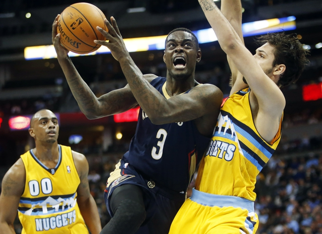 Apr 2, 2014; Denver, CO, USA; New Orleans Pelicans guard Anthony Morrow (3) drives to the basket against Denver Nuggets guard Evan Fournier (94) during the first half at Pepsi Center. Mandatory Credit: Chris Humphreys-USA TODAY Sports